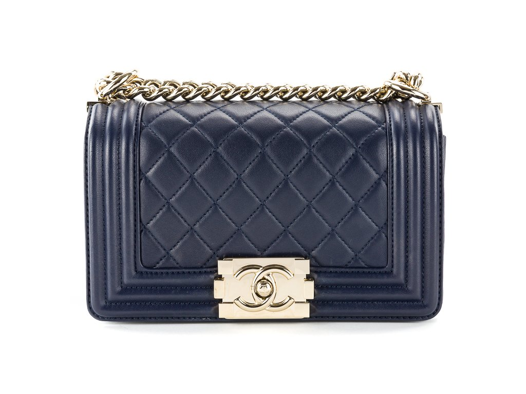 5ec7fc8af Chanel Boy Bag Mini dark blue quilted lambskin with gold tone hardware.